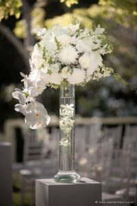 Luxury white wedding ceremony white flower spheres with orchids, roses and other white flowers