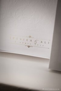 White and gold wedding stationery programs with couples Wedding logo