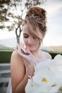 Bridal portrait. Bride holding butterfly after beautiful butterfly release