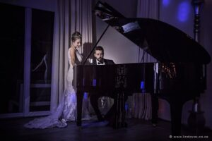Luxury wedding, groom playing black baby grand piano