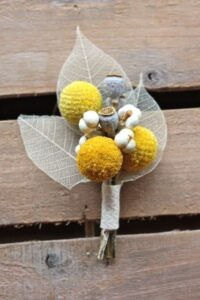 Gray and yellow boutonniere