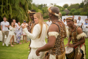 Zulu dancers, interacting with guests.